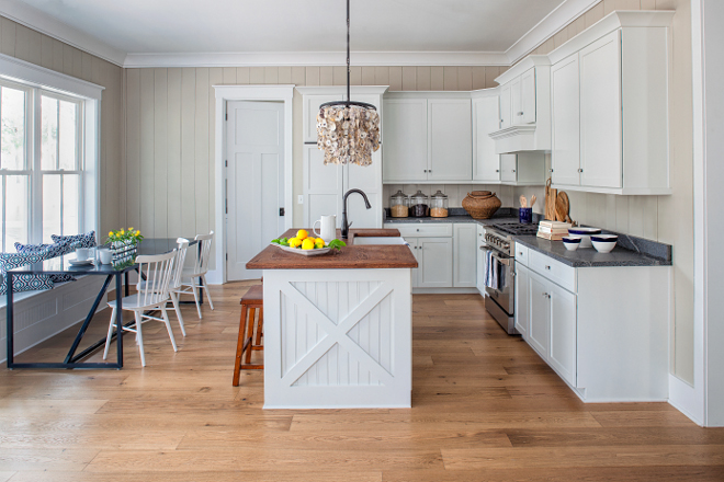 Farmhouse Kitchen. Simple farmhouse kitchen with crisp white cabinets painted in Sherwin Williams Pure White and vertical shiplap walls painted in Sherwin Williams Only Natural #farmhouse #kitchen #farmhousekitchen Lisa Furey - Barefoot Interiors