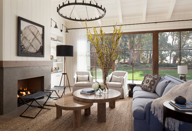 Farmhouse living room with vertical shiplap, Limestone fireplace surround and large glass doors. Farmhouse living room with vertical shiplap, Limestone fireplace surround and large glass doors. Farmhouse living room with vertical shiplap, Limestone fireplace surround and large glass doors #Farmhouselivingroom #verticalshiplap #Limestone #fireplacesurround #largeglassdoors Jennifer Robin Interiors
