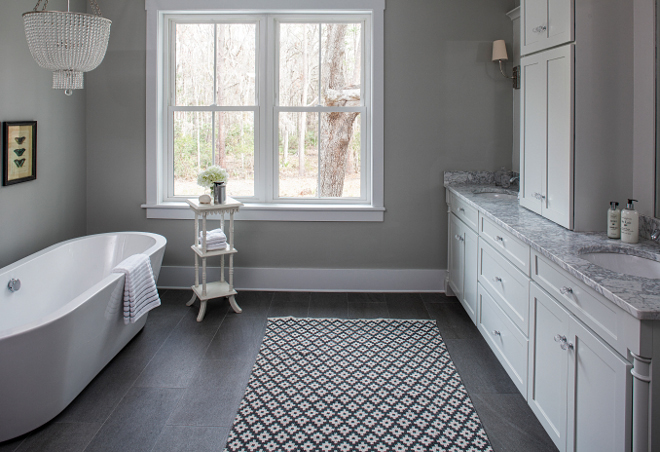 Grey paint color Sherwin Williams Aloof Grey. Bathroom features grey walls painted in Sherwin Williams Aloof Grey and grey slate stone floor tile. Grey paint color Sherwin Williams Aloof Grey #SherwinWilliamsAloofGrey Lisa Furey - Barefoot Interiors