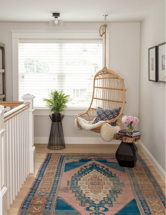 Hanging Rattan Chair. Landing area with Hanging Rattan Chair. Cozy landing area nook with hanging rattan chair and Turkish rug.  Great spot to read a book. Hanging Rattan Chair #HangingRattanChair #swingchair Jamie Keskin Design