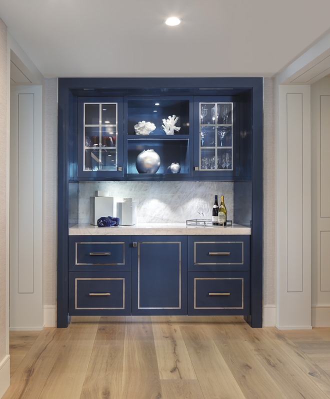 "Hudson Bay 1680 by Benjamin Moore High gloss cabinet. High-gloss navy lacquer wet bar. Hudson Bay 1680 by Benjamin Moore. This high-gloss navy lacquer bar is a total crowd-stopper (and pleaser!). The countertop and backsplash is an exquisite material called Cristallo with a 2.5"" mitered edge detail. Hudson Bay 1680 by Benjamin Moore #BenjaminMoore1680HudsonBay High gloss cabinet. High-gloss navy lacquer wet bar ideas. Cristallo quartzite. #Cristalloquartzite High gloss cabinet. High-gloss navy lacquer wet bar. High gloss cabinet. High-gloss navy lacquer wet bar #Highglosscabinet #Highgloss #navylacquercabinet #wetbar #BenjaminMooreHudsonBay W Design"
