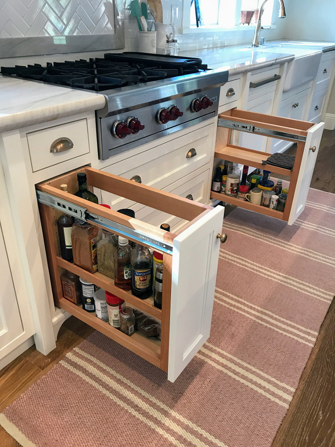 Kitchen Built In Spice Racks. Kitchen pull out spice rack ideas. These pull out racks flank the cooktop and are perfect to store cooking oils and spices. Kitchen Spice and Oil Pull Out Racks flanking range #BuiltInSpiceRacks #kitchenBuilt #SpiceRacks #PullOutspiceRacks Home Bunch Interior Design
