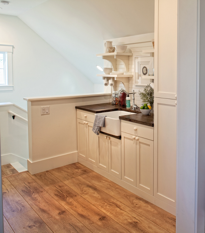"Kitchenette. Farmhouse Kitchenette. This kitchenette is not only beautiful but very practical with its own sink and plenty of cabinetry. Paint color is Benjamin Moore ""White"". Kitchenette. Kitchenette. Kitchenette #farmhouseKitchenette #Kitchenette Lisa Furey of Barefoot Interiors"
