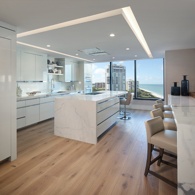 Modern White Kitchen. Sleek Modern White Kitchen. This kitchen is the epitome of crisp, clean and contemporary. My favorite parts- the porcelain countertops (great scratch-proof, durable material) and the custom, nearly transparent cabinetry. Modern White Kitchen #ModernWhiteKitchen W Design