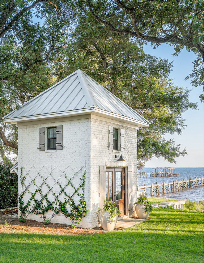 Modern farmhouse shed. Modern farmhouse shed with painted brick and metal roof exterior. Garderning shed #shed #modernfarmhouse #garderningshed #paintedbrick #modernfarmhouseshed #farmhouseshed #metalroof Dalrymple | Sallis Architecture
