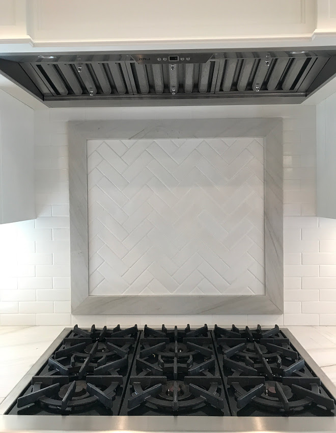 Quartzite Framed Herringbone Accent Tile above range. Kitchen features Quartzite Framed Herringbone Accent Tile above range. We used the same backsplash tile in a herringbone pattern above the cooktop and framed it with the same countertop material; Mont Blanc quartzite. Quartzite Framed Herringbone Accent Tile above range #Quartzite #Framedquartzite #Herringbone #AccentTileaboverange #Tileaboverange Home Bunch Interior Design