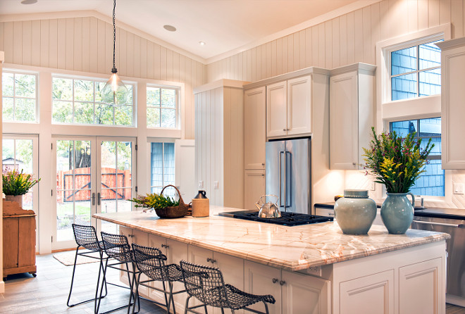 White Farmhouse Kitchen with Vertical Shiplap. Beautiful kitchen with vaulted high ceilings and French doors with transoms to patio. White Farmhouse Kitchen with Vertical Shiplap. White Farmhouse Kitchen with Vertical Shiplap. White Farmhouse Kitchen with Vertical Shiplap #WhiteFarmhouseKitchen #VerticalShiplap