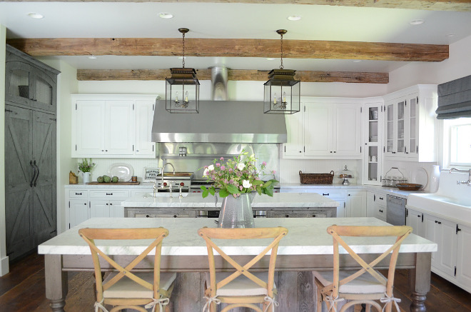 White Farmhouse kitchen with barnwood pantry. White Farmhouse kitchen with barnwood pantry. White Farmhouse kitchen with barnwood pantry. White Farmhouse kitchen with barnwood pantry #WhiteFarmhousekitchen #barnwoodpantry Beautiful Homes of Instagram @SanctuaryHomeDecor