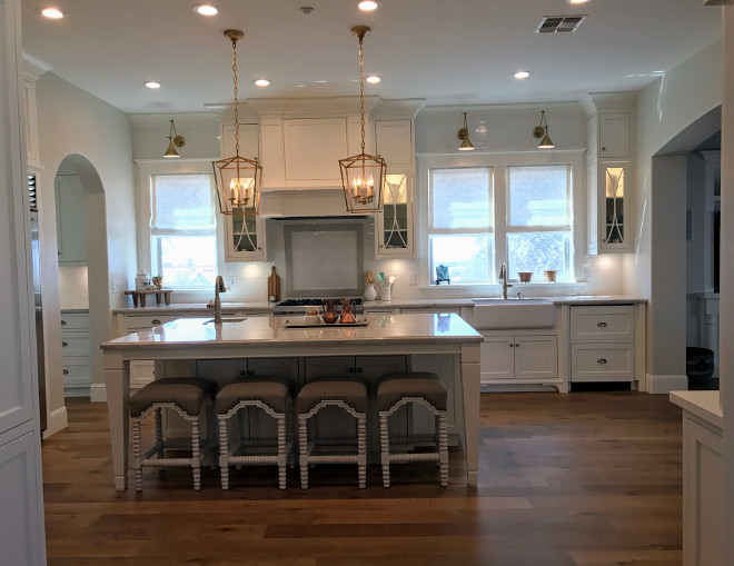 White kitchen with brass lighting. Classisc White kitchen with brass lighting. White kitchen with brass lighting #Whitekitchen #brasslighting Home Bunch Interior Design
