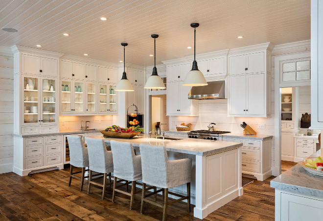 White kitchen with shaker style cabinets, beadboard ceiling, glass cabinets, wide plank floors, painted wood shiplap walls and shiplap backsplash. White kitchen with shaker style cabinets, beadboard ceiling, glass cabinets, wide plank floors, painted wood shiplap walls and shiplap backsplash #Whitekitchen #shakerstylecabinets #beadboardceiling #glasscabinets #wideplankfloors #paintedwoodshiplap #paintedshiplap #whitewashedshiplap #shiplapbacksplash Mitch Wise Design,Inc.