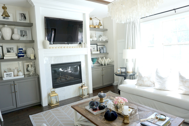 White living room with grey cabinets and bookshelves. White living room with grey cabinets and bookshelves. White living room with grey cabinets and bookshelves. White living room with grey cabinets and bookshelves #Whitelivingroom #greycabinets #bookshelves @myhouseoffour