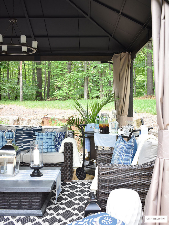 outdoor-gazebo-with-wicker-furniture-and-fire-table-decorated-with-blue-and-white-accents Beautiful Homes of Instagram @citrineliving Home Bunch