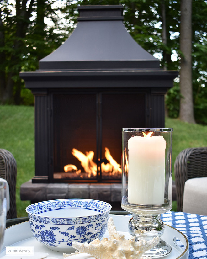 outdoor-patio-fireplace-lounge-area-mercury-glass-hurricane-candle-blue-and-white-decor Home Bunch Beautiful Homes of Instagram @citrineliving