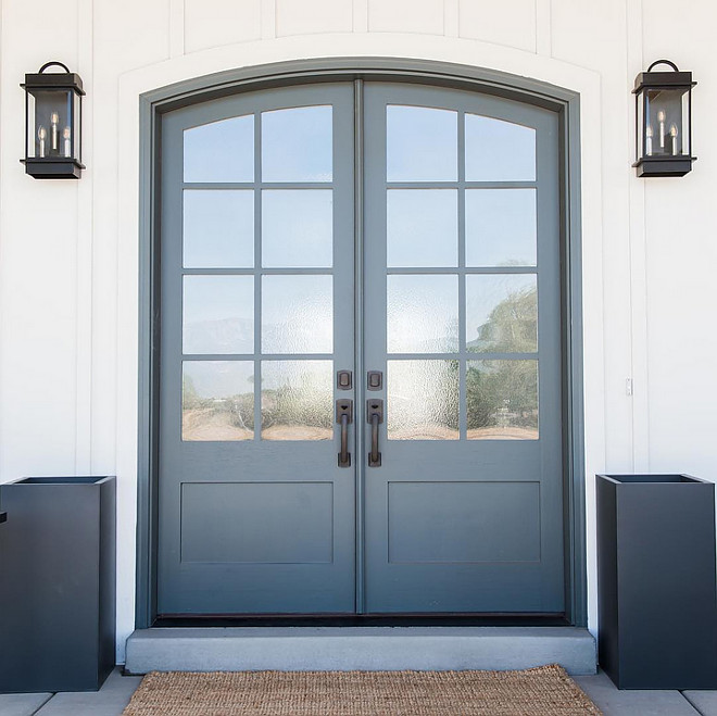 Arched front door is solid wood painted in Farrow and Ball Down Pipe. Millhaven Homes
