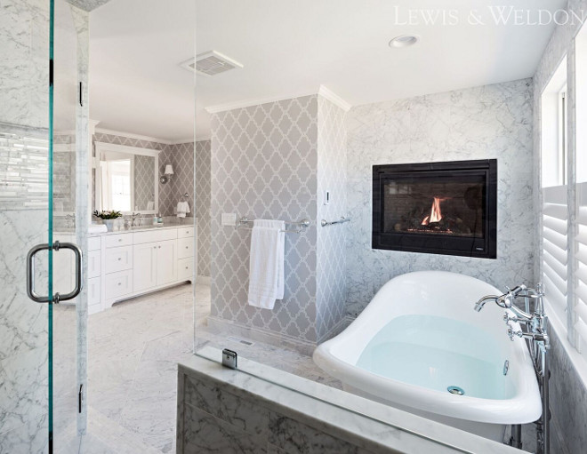 Bathoom features a combination of grey wallpaper and Carrara marble tile. Grey wallpaper is Thibaut Stanbury Trellis, color Grey. Lewis & Weldon Custom Kitchens
