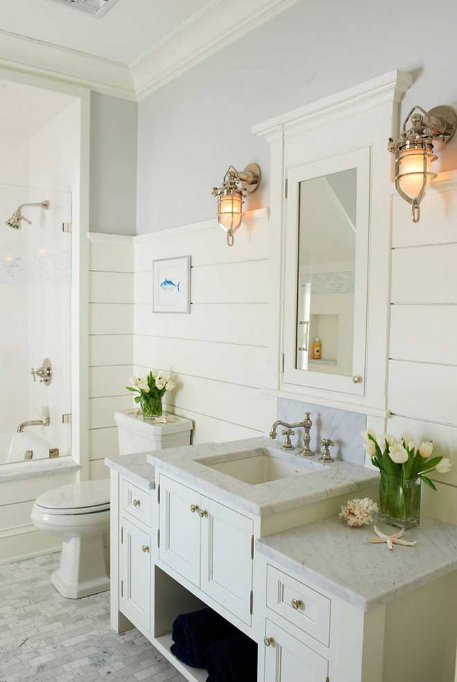 Beach House Bathroom Design with shiplap walls and coastal lighting. Shoreline Painting & Drywall, Inc