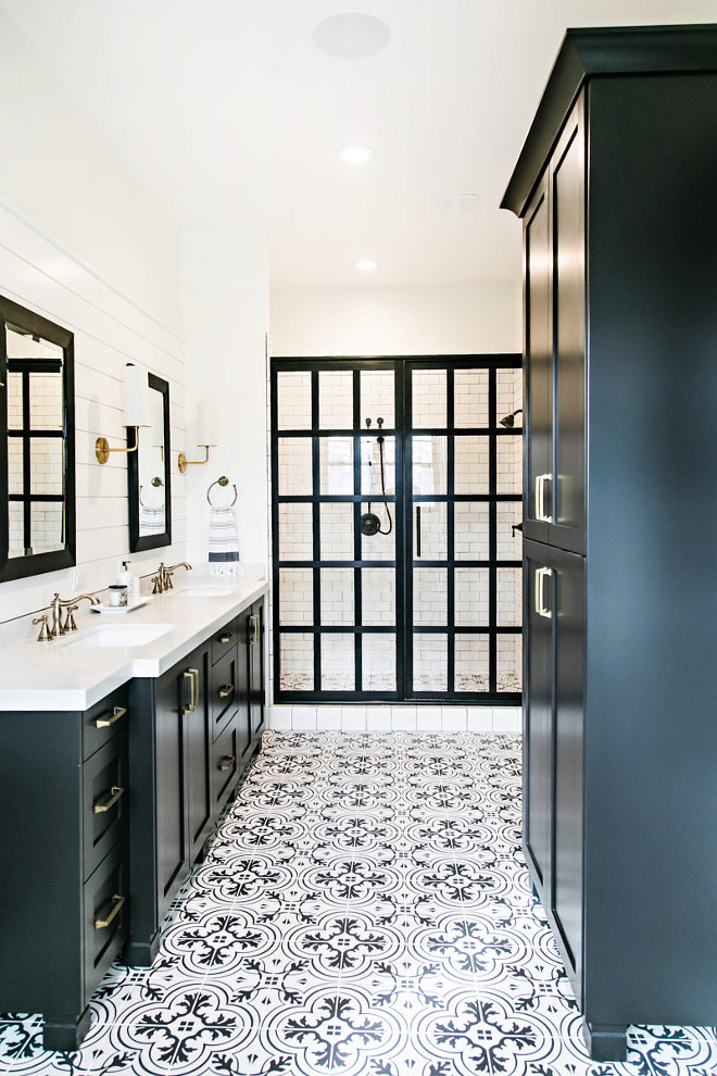 Black Beauty by Benjamin Moore. Black Beauty by Benjamin Moore Farmhouse bathroom with black cabinets, painted in Black Beauty by Benjamin Moore, custom framed shower doors and black and white tile. Rather than installing pricey cement tile, the designer used porcelain tiles that features the same designs but it's much more affordable and low-maintenance. #BlackBeautybyBenjaminMoore Sita Montgomery Interiors
