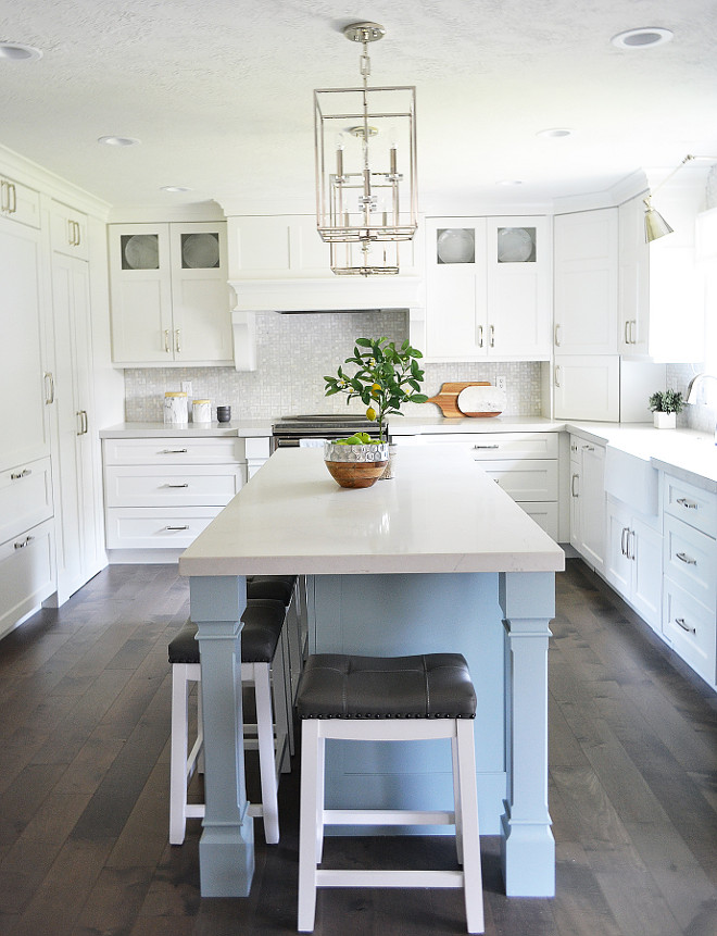 Blue kitchen island. Light blue kitchen island. A blue kitchen island brings some color to this white kitchen. Blue kitchen island #bluekitchenisland Sita Montgomery Interiors