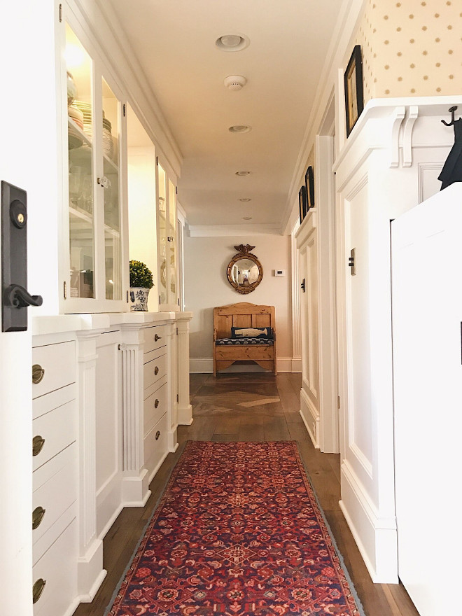Butlers pantry. Classic Butlers pantry. Back pantry has a butler's vibe. Antique rug was a gift from a friend. Pine bench is an antique. Whale pillow from Homegoods. Mirror is antique from Mountain Dandy in Jackson Hole. Star wallpaper is Osborne & Little. #Butlerspantry Beautiful Homes of Instagram @SweetShadyLane
