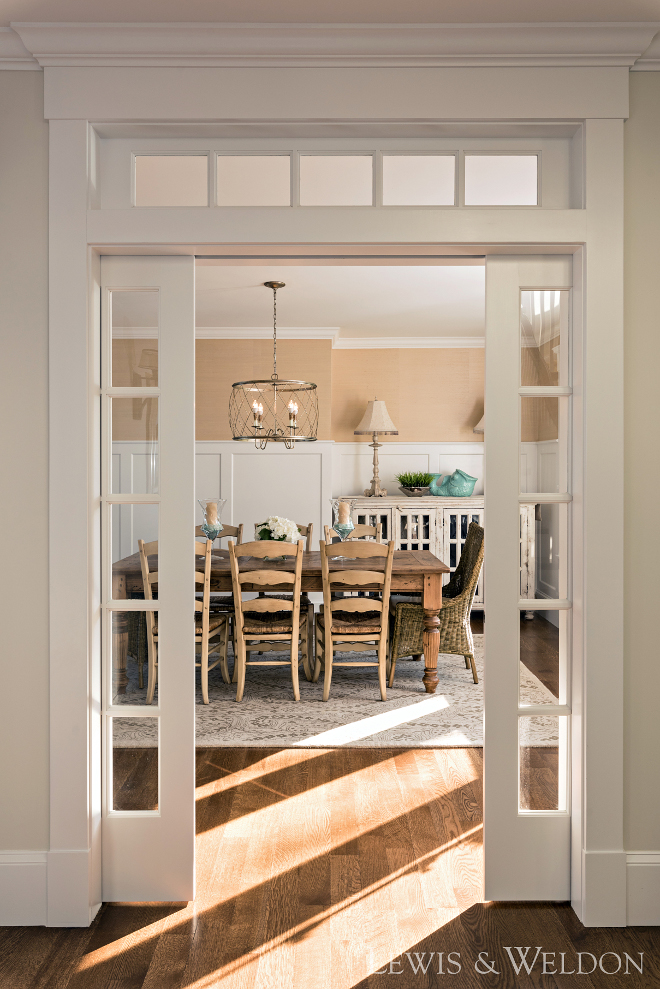 Dining room glass pocket doors and transoms. These glass pocket doors and transoms creates a sense of intimacy to this dining room. #Diningroom #glasspocketdoors #transoms Lewis & Weldon Custom Kitchens