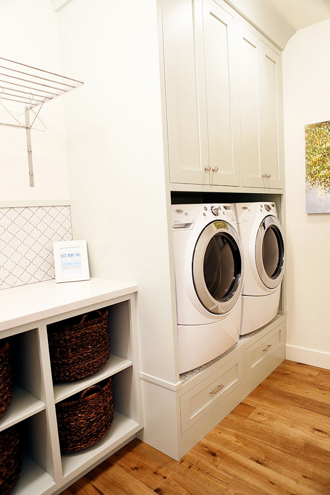 Elevated washer and dryer. Laundry room with elevated washer and dryer - great idea to help your back and add extra storage! Cabinet paint color is Benjamin Moore Gray Cashmere. Laundry room with Elevated washer and dryer. Laundry room with built-in cabinets and elevated washer and dryer #Elevatedwasheranddryer #laundryroom Millhaven Homes. Caitlin Creer Interiors