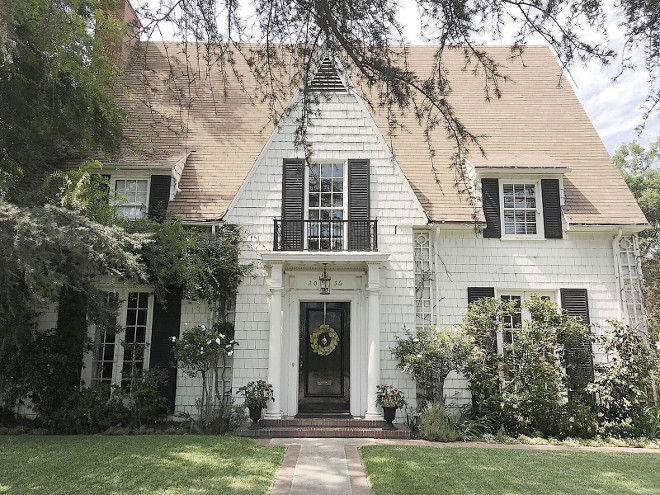 Exterior Paint is Dunn Edwards Swiss Coffee and the black shutters and door is Dunn Edwards Black.Beautiful Homes of Instagram @my100yearoldhome