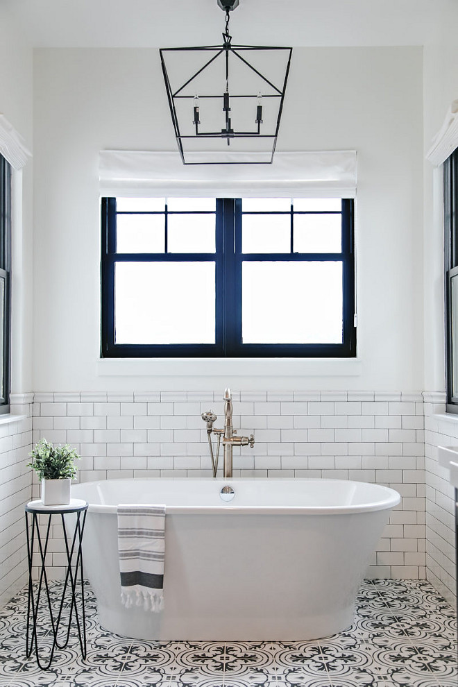 Farmhouse bathroom tub ideas. Farmhouse bathroom with freestanding tub, white subway tile walls, black and white patterned tiles and black steel windows. #bathroom #farmhousebathrooms #blacksteelwindow #patternedtile #subwaytile #walltile Sita Montgomery Interiors