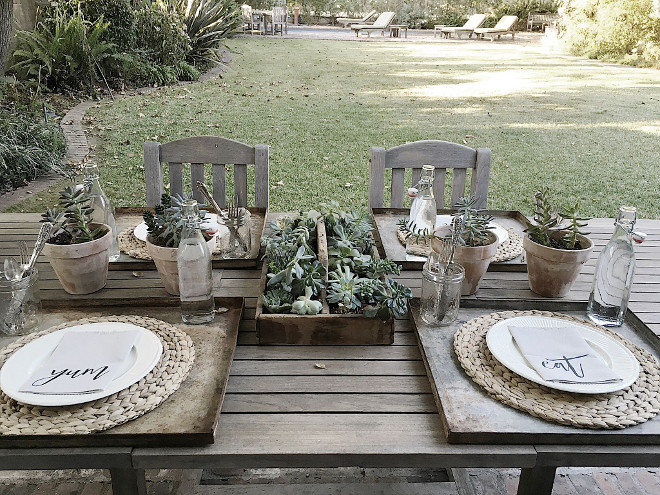 Farmhouse outdoor dining with teak table teak chairs and succulents. We dine under the chandelier hanging from the tree all of the time. It's the perfect setting to entertain guests. #farmhouse #outdoordining #teaktable #teakchairs #succulents Beautiful Homes of Instagram @my100yearoldhome
