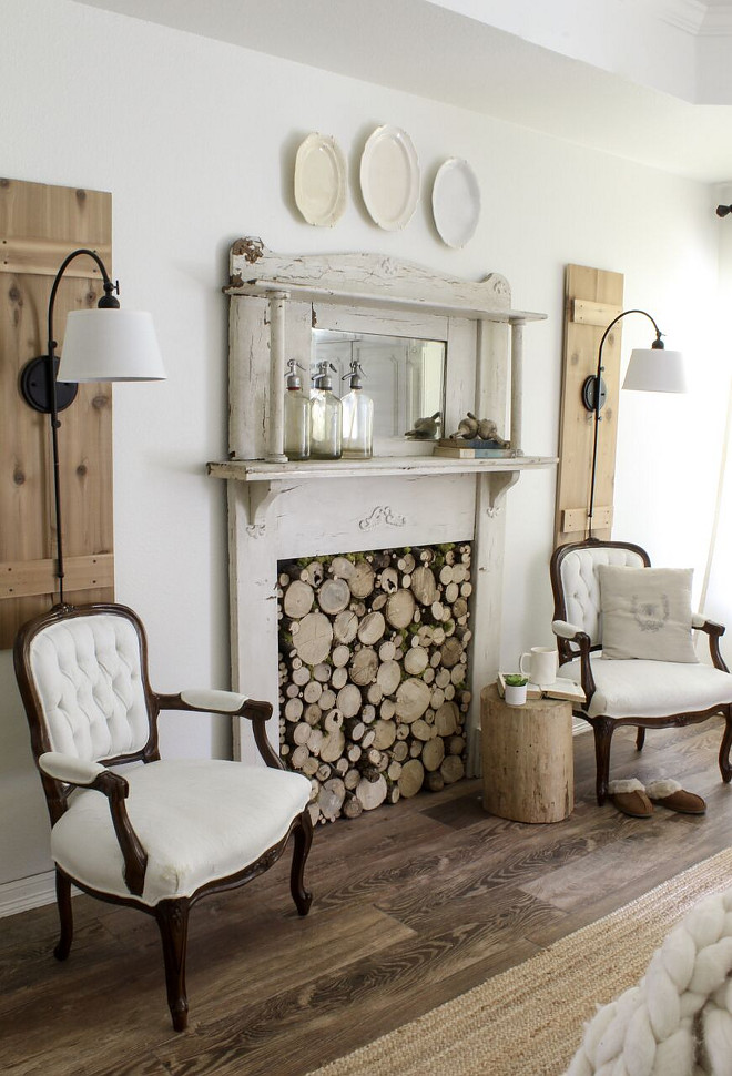 Fireplace early 1900's vintage mantel w DIY wood slice insert and antique French chairs. Home Bunch Beautiful Homes of Instagram @cottonstem