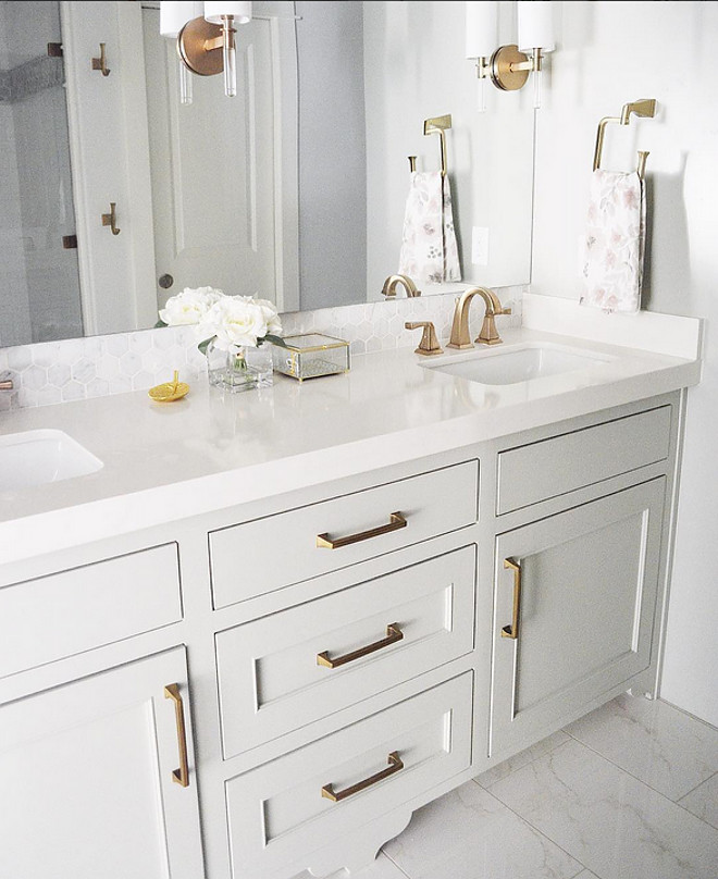 Light grey cabinet paint color. Gray Cashmere by Benjamin Moore. This light grey paint color works great with white marble or white quartz countertop and brass hardware. Gray Cashmere by Benjamin Moore. Gray Cashmere by Benjamin Moore #GrayCashmerebyBenjaminMoore Sita Montgomery Interiors