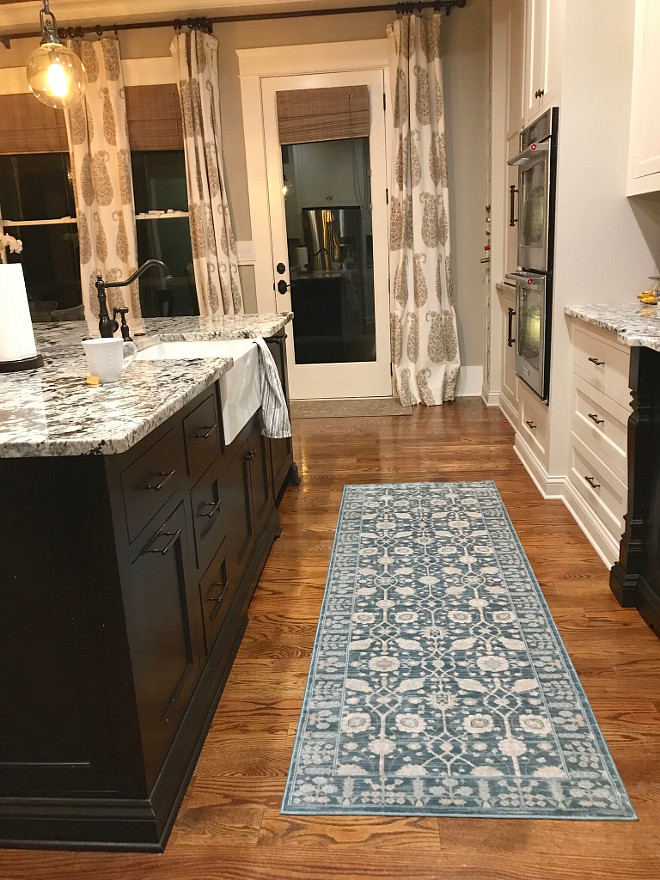Kitchen Runner. Blue and white kitchen runner. Farmhouse kitchen with black island, hardwood floors and blue and White kitchen runner #kitchenrunner Home Bunch Beautiful Homes of Instagram @mygeorgiahouse