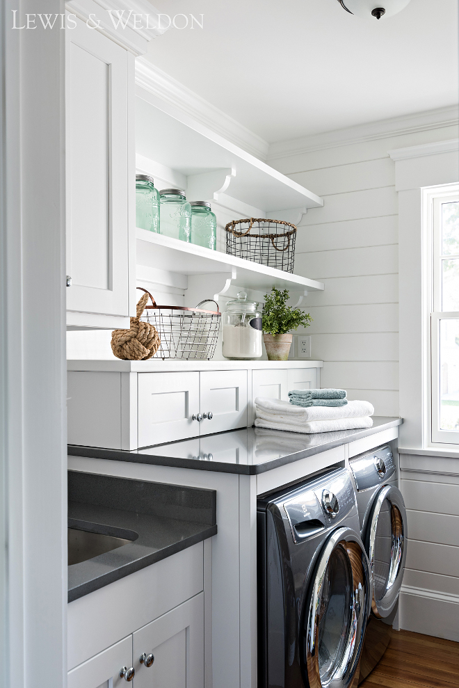 Laundry room with sink cabinet layout. This is not a big laundry room but the cabinet layout with sink offers a lot of storage and folding space. #Laundryroom #sink #cabinet #layout Lewis & Weldon Custom Kitchens