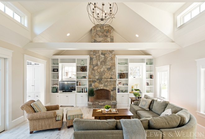 Living room with vaulted ceiling and stone fireplace. Lewis & Weldon Custom Kitchens