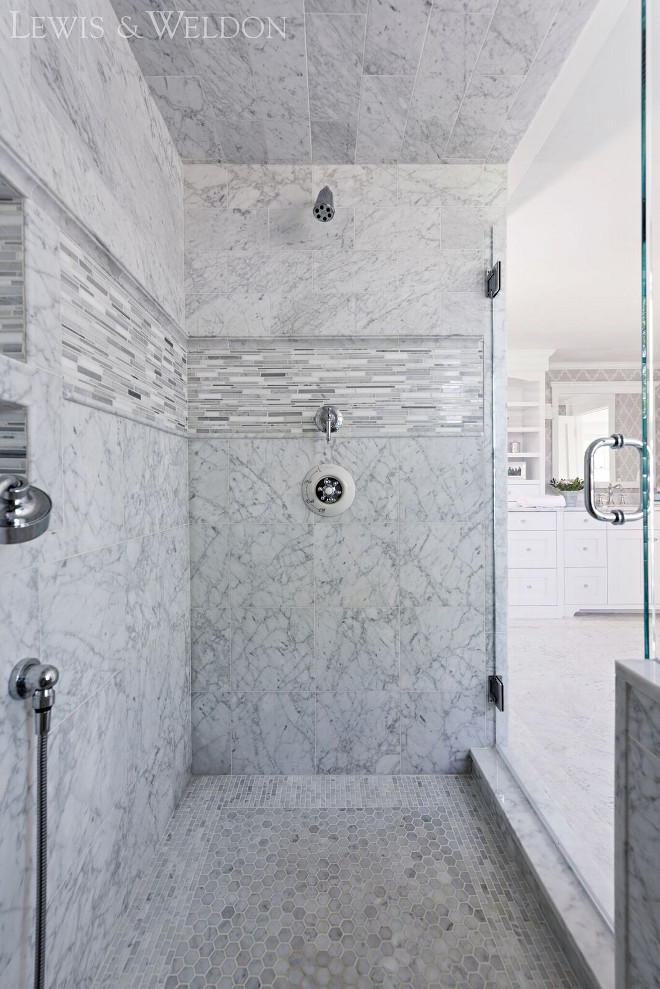 Marble Shower Tile Combination Ideas. The shower combines many different sizes of carrara marble tile from floor-to-ceiling. Marble Shower Tile Combination Ideas. Marble Shower Tile Combination Ideas. Marble Shower Tile Combination Ideas. Marble Shower Tile Combination Ideas #MarbleShowerTileCombination #MarbleShowerTileCombinationIdeas Lewis & Weldon Custom Kitchens