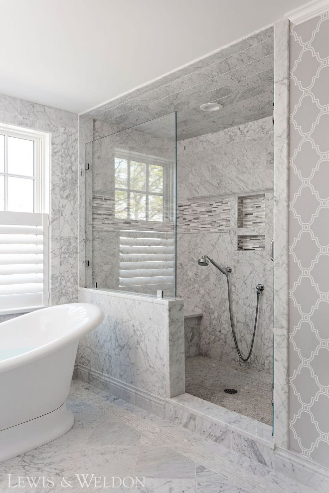 Marble Shower Tile. This shower features different sizes of Carrara marble tile from floor to ceiling. #bathroom #shower #marbletile #carrara Lewis & Weldon Custom Kitchens