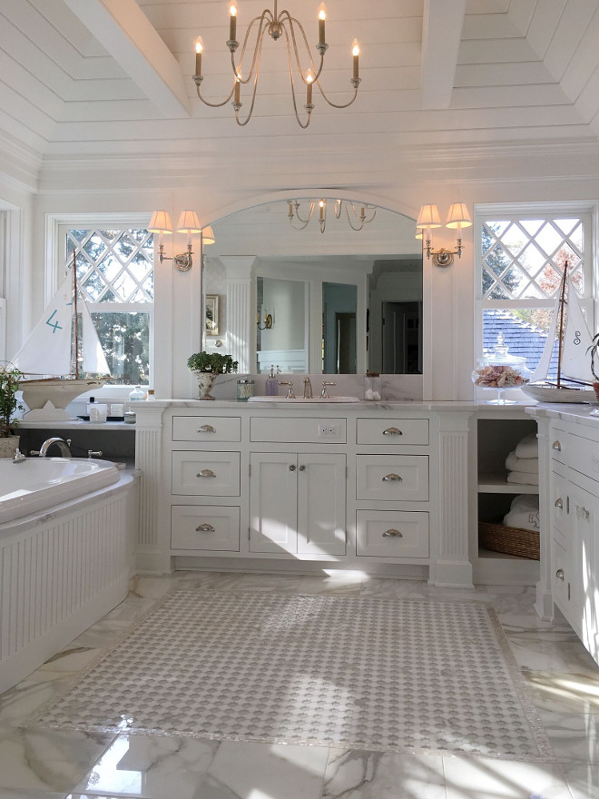 Master Bathroom. Classic master bathroom. White master bathroom with marble flooring. The master bath has diamond windows on both sides of vanity. It's white on white with marble floors #masterbathroom Beautiful Homes of Instagram @SweetShadyLane