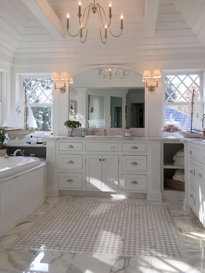 Master Bathroom. Classic master bathroom. White master bathroom with marble flooring. The master bath has diamond windows on both sides of vanity. It's white on white with marble floors #masterbathroom Beautiful Homes of Instagram @SweetShadyLane