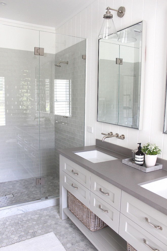 Modern farmhouse bathroom. Neutral Modern farmhouse bathroom. Modern farmhouse bathroom with vertical shiplap, grey quartz countertop, grey shower tile and hex marble floor tile #modernfarmhousebathroom #farmhousebathroom Beautiful Homes of Instagram @urban_farmhouse_build