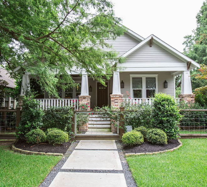 Restored 1920s American Craftsman style bungalow located in the Historic Heights District of Houston, Texas. The exterior of the home features custom shaker siding and custom millwork and trim - architectural details that are common in American Craftsman style homes.  Marie Flanigan Interiors