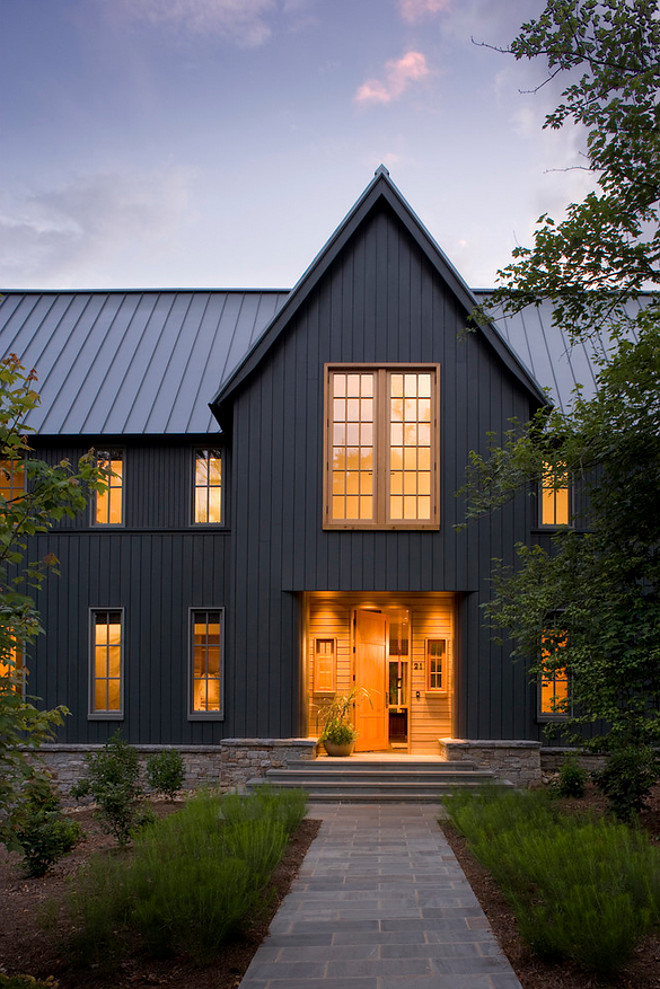 Rock Bottom from Sherwin Williams. Deep gray black charcoal modern farmhouse exterior paint color Rock Bottom from Sherwin Williams in satin finish. Window trim is is Sherwin Williams Attitude Grey. Rock Bottom from Sherwin Williams. Rock Bottom from Sherwin Williams #RockBottomSherwinWilliams Carlton Edwards Architects