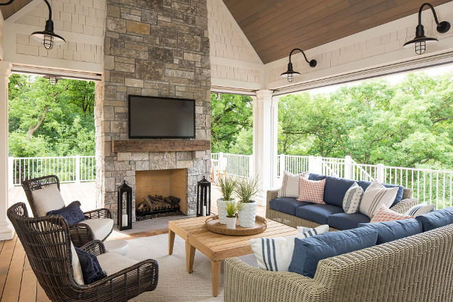 Screened porch with stone fireplace, vaulted ceiling and coastal farmhouse lighting. This screened porch features a stunning stone fireplace with timber mantel, a comfortable seating area, vaulted ceilings and coastal farmhouse lighting. Screened porch with stone fireplace, vaulted ceiling and coastal farmhouse lighting. Screened porch with stone fireplace, vaulted ceiling and coastal farmhouse lighting. Screened porch with stone fireplace, vaulted ceiling and coastal farmhouse lighting #Screenedporch #stonefireplace #vaultedceiling #coastalfarmhouse #lighting Martha O'Hara Interiors