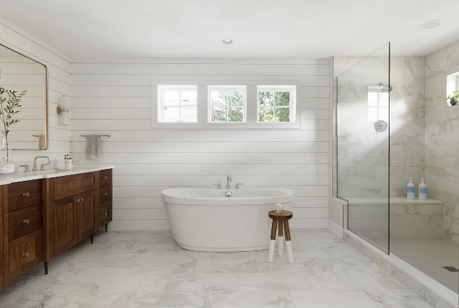 Shiplap bathroom. Clean lined bathroom with shiplap paneling and white marble flooring and shower tile. Refined LLC