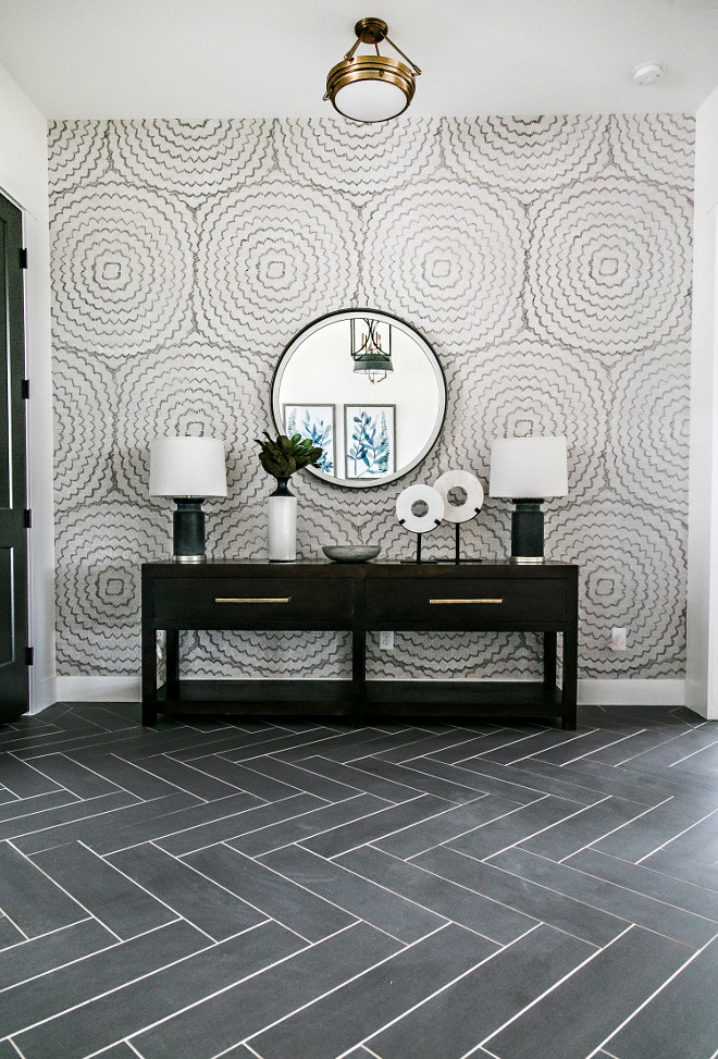 Herringbone tile floor. Entry with herringbone tile floor. This entry features a herringbone floor tile and a beautiful wallpaper. Tile is Arizona Tile Cebu, color: Silver - they were cut down and set on a herringbone pattern. herringbone tile floor. herringbone tile floor #herringbonetilefloor #herringbonetile #herringbonefloor #tile #entry Sita Montgomery Interiors