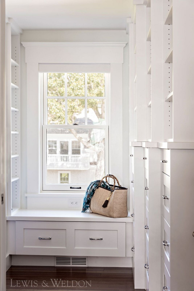 Walk in closet cabinet paint color Benjamin Moore PM-2 White. Custom cabinetry with recessed panel, rounded inside edge detail-Maple painted Benjamin Moore PM-2 White