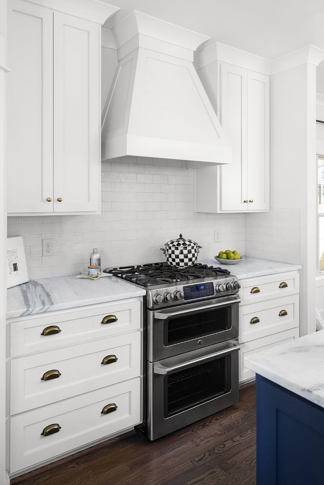 White and nblue kitchen. Cabinets are poplar wood shaker style cabinets. White kitchen cabinet painted in Benjamin Moore OC-17 White Dove and navy island. #Benjaminmoorewhitedove #Benjaminmooreoc17whitedove #whitekitchen #navyisland Willow Homes