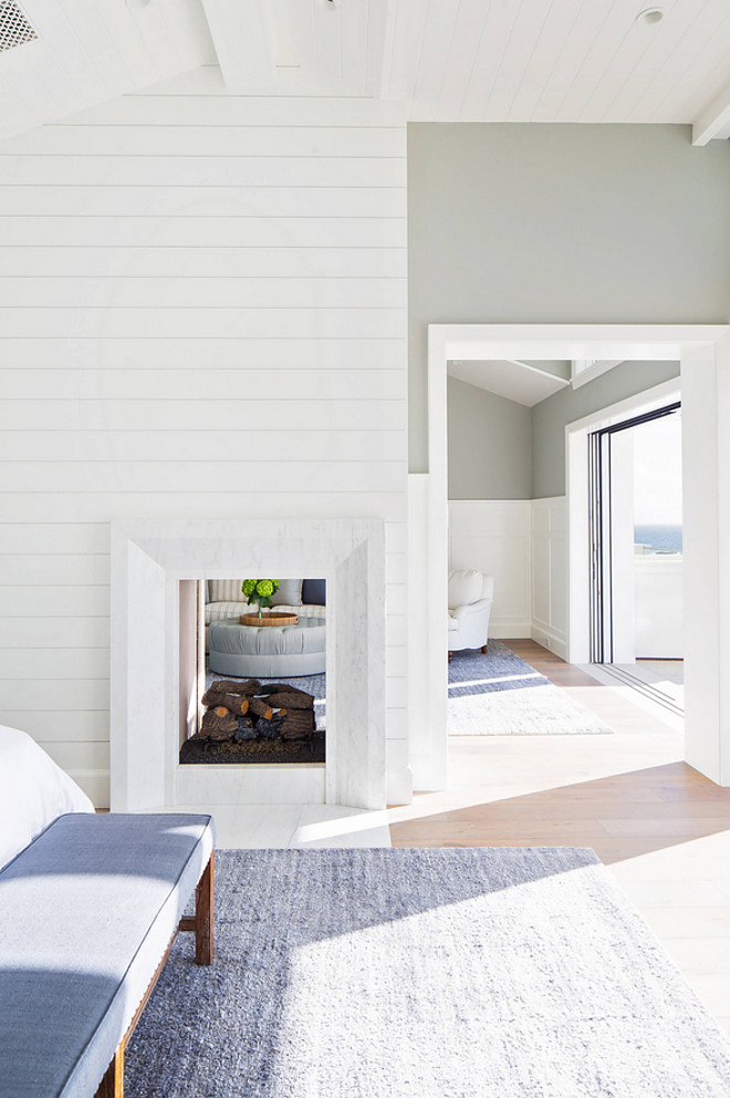 A Two-sided fireplace separates the master bedroom to the sitting area