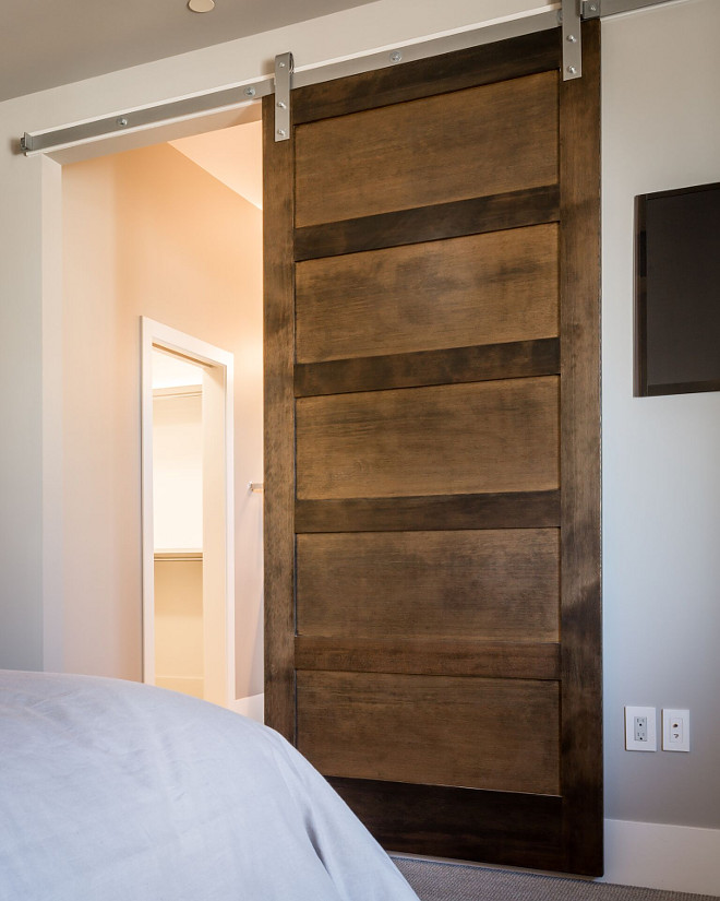 Bedroom Barn Door An Alder barn door conceals the master bedroom from the master bathroom #Bedroombarndoor #barndoor #Alderbarndoor