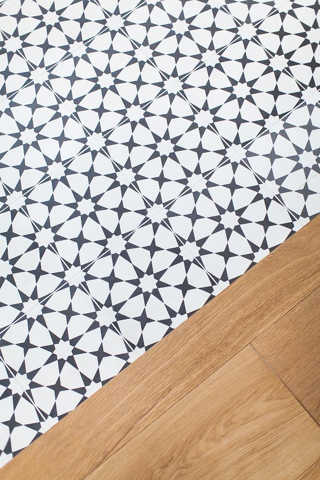 Bedroom hardwood floor transition to master bathroom cement tile floor tile