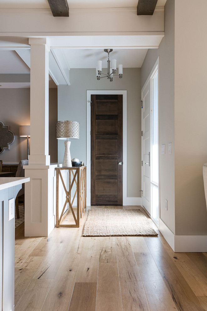 Benjamin Moore HC 172 Revere Pewter with with wide plank European Oak flooring The foyer opens to a bright home with wide plank European Oak flooring Paint color is Benjamin Moore HC 172 Revere Pewter