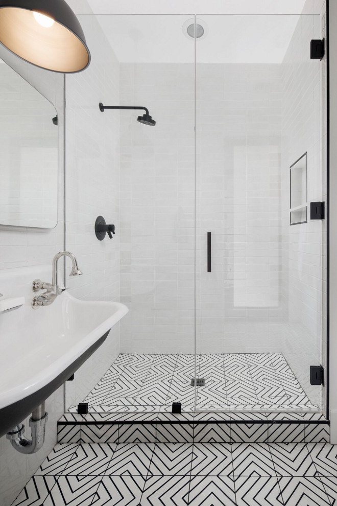 Black and white bathroom tile. Bathroom floor tile is Zenith Moroccan Encaustic Cement Tile from Cle Tile. Notice the Black Schluter trim around the shower. Black and white tile. Modern farmhouse bathroom with black and white cement tile. #blackandwhite #bathroom #floortile #blackandwhitecementtile A Finer Touch Construction